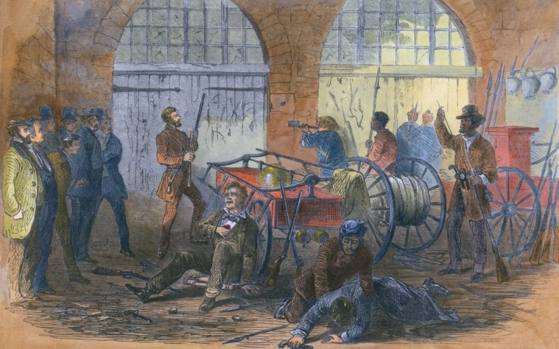 John Brown and others inside the engine house of the Harper's Ferry Armory just before the US Marines ram through the door.