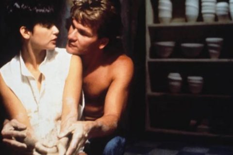 Demi Moore sits in front of Patrick Swayze in a scene from the movie Ghost.