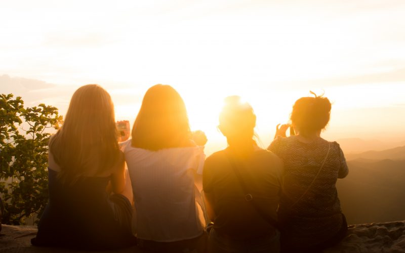 Friends outside watching sunset