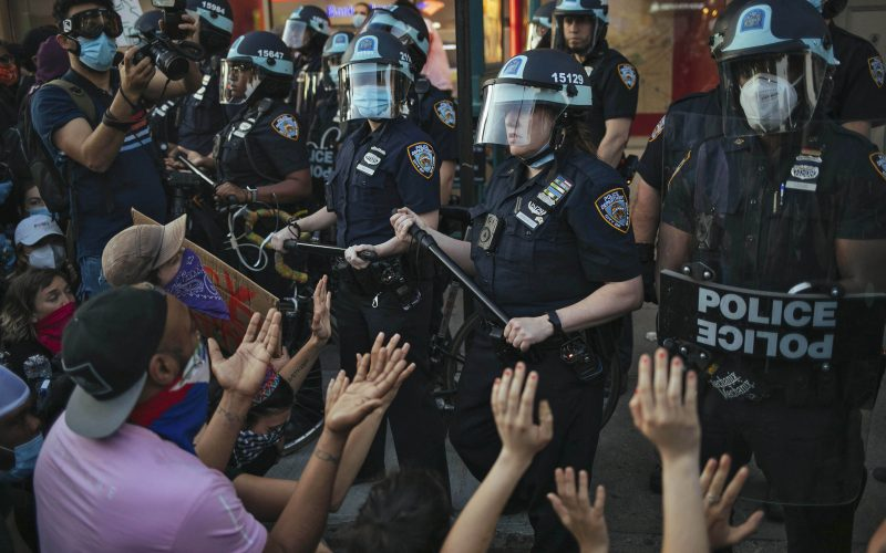 A file photo shows New York City Police facing off with activists during a protest march in the Bedford-Stuyvesant section of the Brooklyn borough of New York.