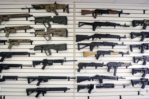 Semi-automatic rifles fill a wall at a gun shop in Lynnwood, Wash.