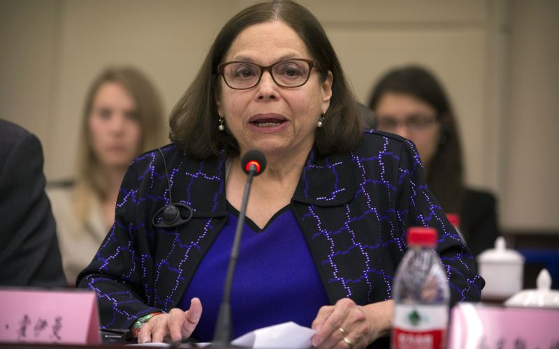 Judith Heumann, special advisor for International Disability Rights at the U.S. Department of State, sits at a table and speaks at the opening session of the China-U.S. Coordination Meeting on Disability in Beijing.