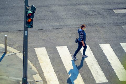 A person crosses the street.