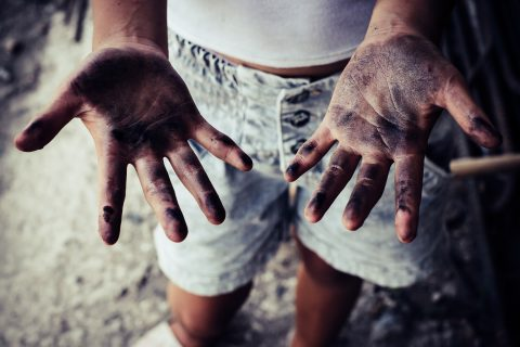 Photo illustration of a child's dirty hands.