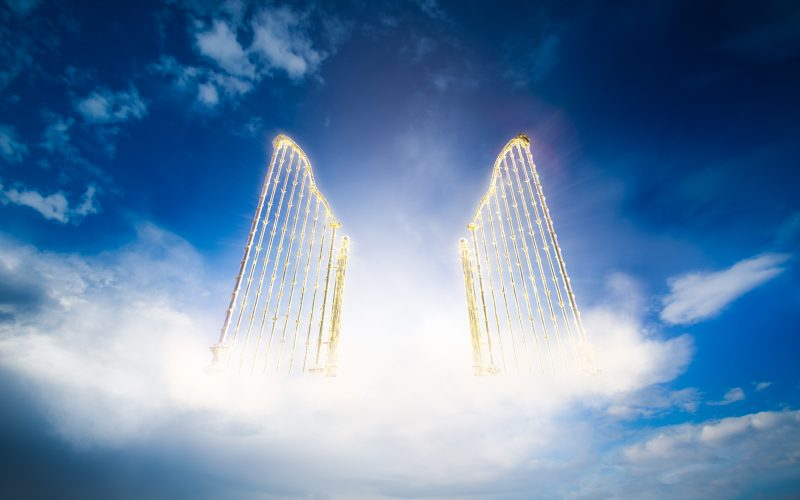 A photo illustration of an open gate to heaven.