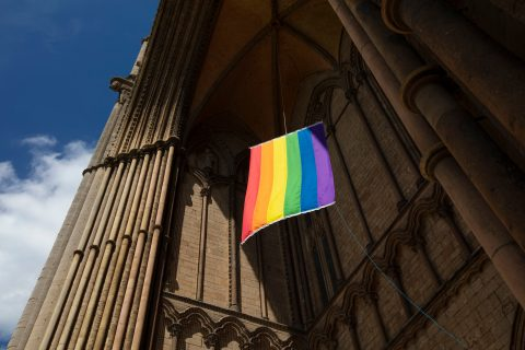 A view of a Pride flag hanging from Peterborough Cathedral