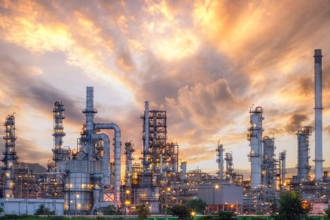 Landscape image of and oil and gas refinery area.