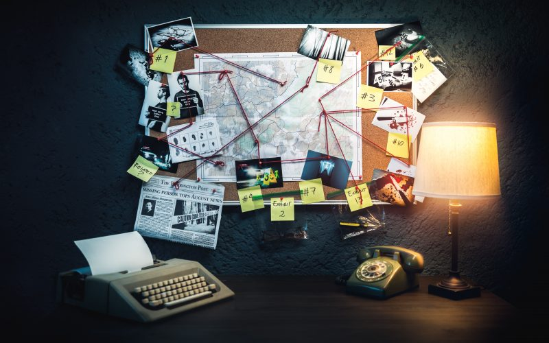 Photo illustration of a detective board with evidence, crime scene photos and map.