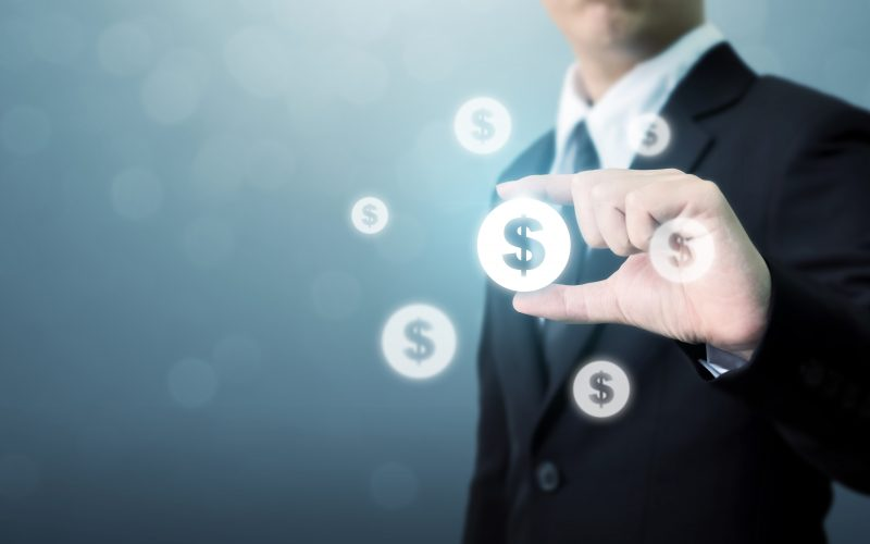 Businessman Holding Dollar